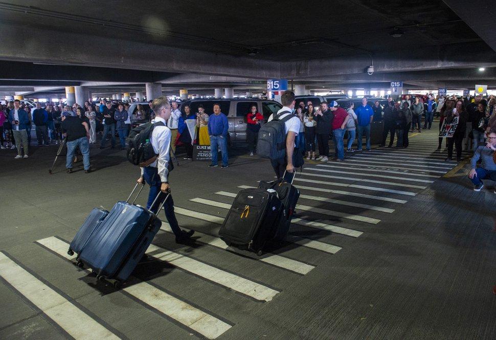 (Rick Egan | The Salt Lake Tribune) Missionaries from the Philippines return the Salt Lake City International Airport, Sunday, March 22, 2020.