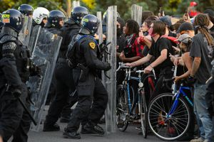 (Trent Nelson  | Tribune file photo) Police push back protesters in Salt Lake City in this July 9, 2020, file photo. The Utah Legislature is considering legislation that would require a person arrested for rioting to appear before a judge before being released.