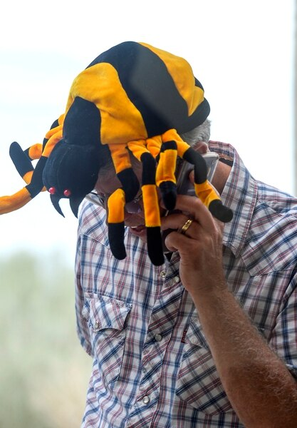 (Leah Hogsten | The Salt Lake Tribune) Dirk Burton of West Jordan sports a spider hat at the Antelope Island Spider Fest 2019 at Antelope Island State Park, August 3, 2019. Spider Fest featured a day full of spider-themed presentations, crafts, guided walks, citizen science, poetry, photography, art and educational presentations about the arachnids on the island.