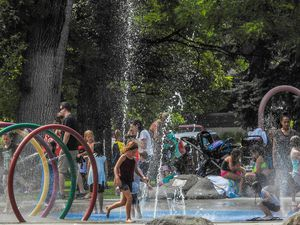 Chris Detrick     The Salt Lake TribuneChildren play in the splash pad in Rotary Playground at Liberty Park Wednesday, July 12, 2017.