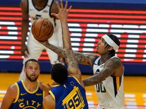 Utah Jazz guard Jordan Clarkson, right, shoots against Golden State Warriors guard Stephen Curry (30) and forward Juan Toscano-Anderson (95) during the first half of an NBA basketball game in San Francisco, Monday, May 10, 2021. (AP Photo/Jeff Chiu)