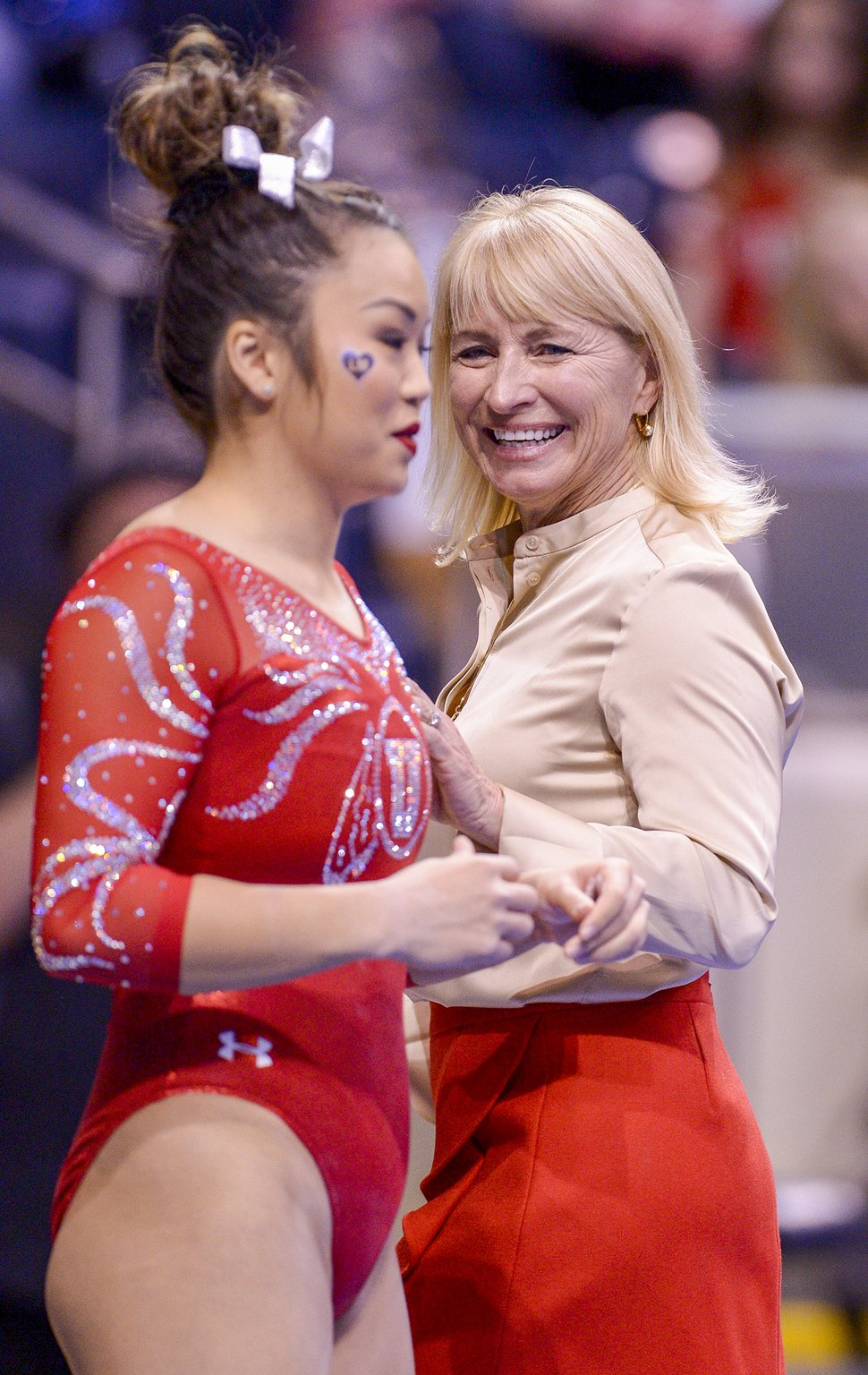 Leah Hogsten | The Salt Lake Tribune Utah's head coach Megan Marsden shares a laugh with Kari Lee before her routine on the beam as No. 3 University of Utah gymnastics team meets BYU gymnastics at the Marriot Center, Jan. 10, 2019.