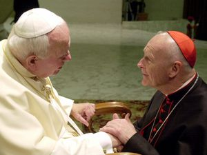 (Massimo Sambucetti | AP file photo) U.S. Cardinal Theodore Edgar McCarrick, archbishop of Washington, D.C., shakes hands with Pope John Paul II at the Vatican, Feb. 23, 2001. A report by the Vatican released Tuesday, Nov. 10, 2020 implicates Pope John Paul II in elevating McCarrick despite allegations of sexual misconduct.