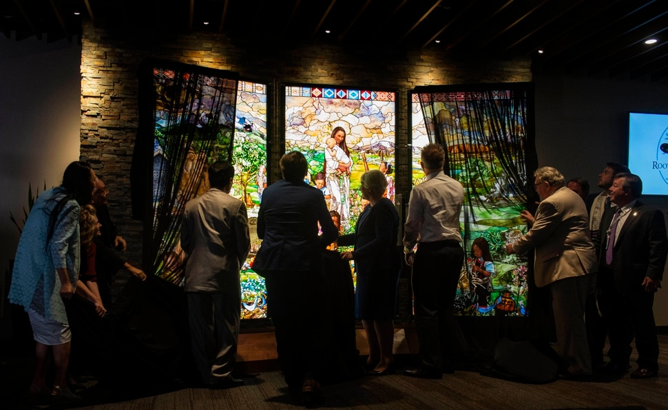 (Rick Egan | The Salt Lake Tribune) Dignitaries unveil the first three of its 7 Pillars windows, created by artist Tom Holdman, during a Roots of Humanity Foundation ceremony, at the 100 Club room at the Vivint Smart Home Arena, Sunday, Aug. 25, 2019.