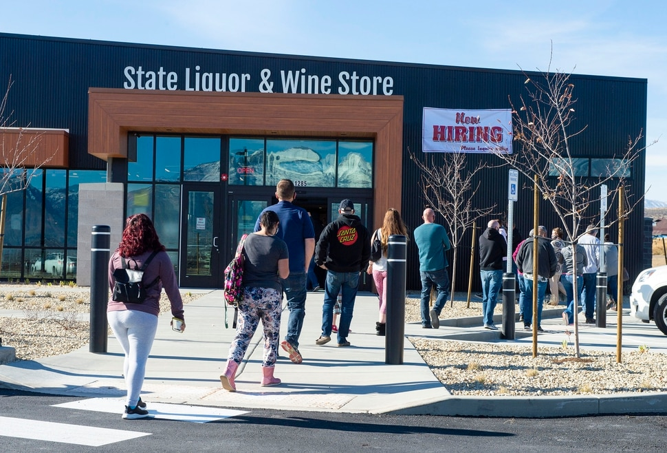 (Rick Egan | The Salt Lake Tribune) Customers line up for the opening of the new state liquor and wine store in Saratoga Springs, on Monday, Nov. 16, 2020.
