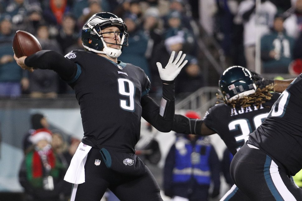 Philadelphia Eagles' Nick Foles passes during the first half of an NFL football game against the Oakland Raiders, Monday, Dec. 25, 2017, in Philadelphia. (AP Photo/Chris Szagola)