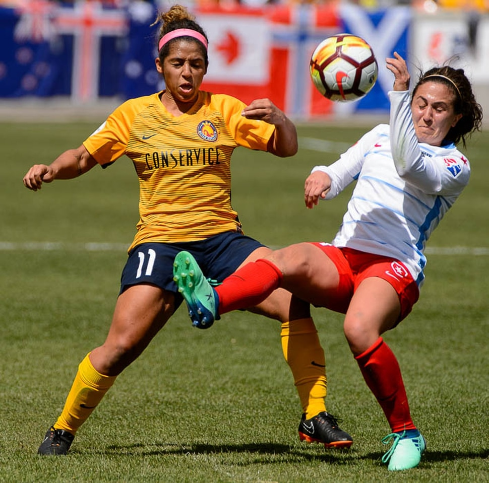 (Trent Nelson | The Salt Lake Tribune) Utah Royals FC hosts the Chicago Red Stars, at Rio Tinto Stadium in Sandy, Saturday April 14, 2018. Utah Royals FC midfielder Desiree Scott (11) and Chicago Red Stars midfielder Danielle Colaprico (24).