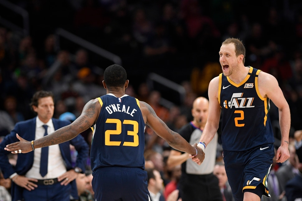 Utah Jazz forward Royce O'Neale (23) reacts with teammate forward Joe Ingles (2) after making a three-point basket during the second half of an NBA basketball game against the Washington Wizards, Sunday, Jan. 12, 2020, in Washington. (AP Photo/Nick Wass)