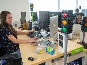 (Rick Egan  |  Tribune file photo)       BambooHR employee Megan Jensen works in the main office building in Lindon last year. BambooHR has ranked high in the Top Workplaces survey for seven years running.