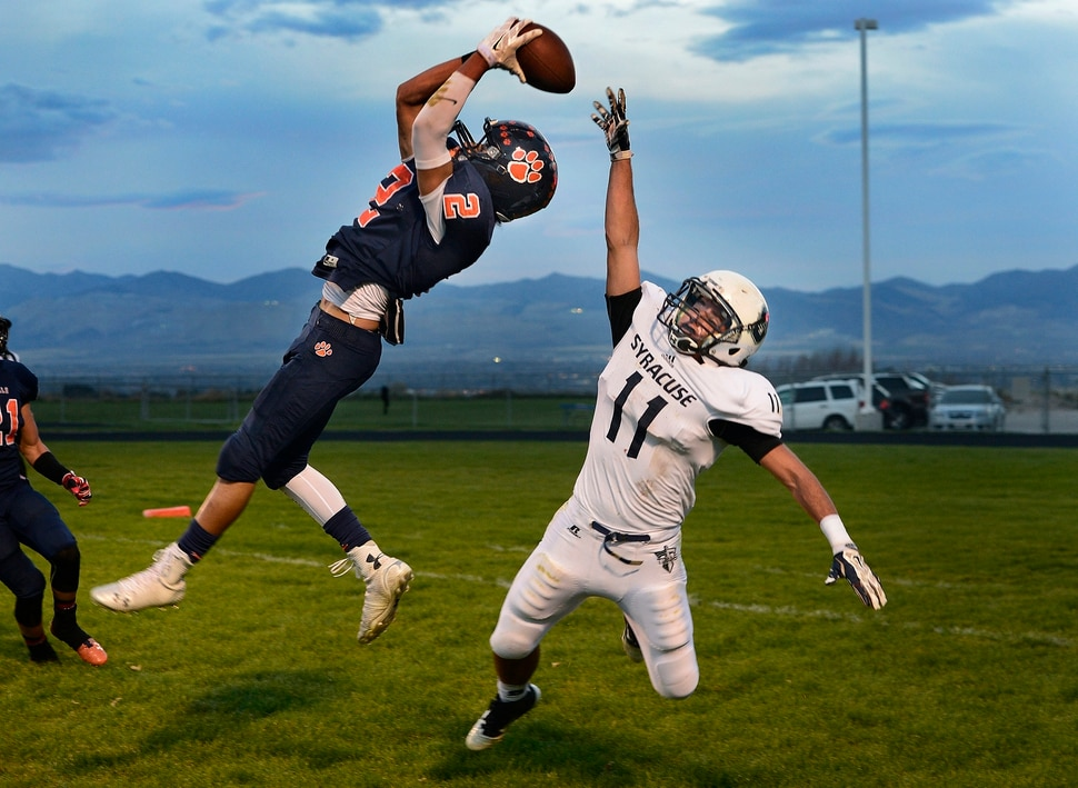 (Scott Sommerdorf | The Salt Lake Tribune) Brighton DB Dylan Pearmain leaps to intercept a pass in the end zone intended for Syracuse WR Dax Harris during second half play. Brighton beat Syracuse 35-14 in a 5A first-round playoff game at Brighton, Friday, October 31, 2014.
