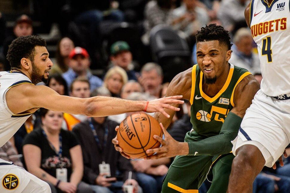 (Trent Nelson | The Salt Lake Tribune) Denver Nuggets guard Jamal Murray (27) reaches in on Utah Jazz guard Donovan Mitchell (45) as the Utah Jazz host the Denver Nuggets, NBA basketball in Salt Lake City on Wednesday Jan. 23, 2019.
