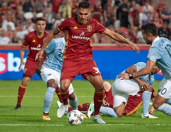 Michael Mangum | Special to the Tribune Real Salt Lake defender Marcelo Silva (30) tries to get a shot with heavy pressure from the Sporting Kansas City defense during their match at Rio Tinto Stadium in Sandy, UT on Saturday, July 22, 2017.