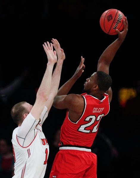 Western Kentucky forward Dwight Coleby (22) shoots over Utah forward David Collette during the first half of an NCAA college basketball game in the semifinals of the NIT, Tuesday, March 27, 2018, in New York. (AP Photo/Julie Jacobson)