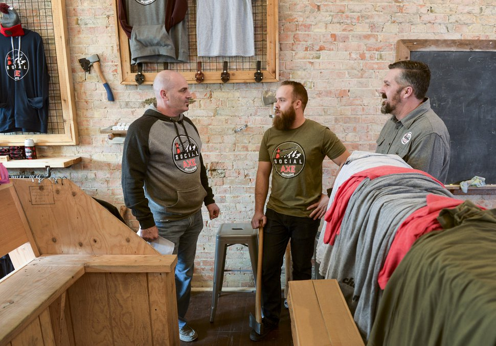 (Leah Hogsten | The Salt Lake Tribune) l-r Social Axe Throwing owners and partners Steve Lister, Brayden Floyd and Mark Floyd.