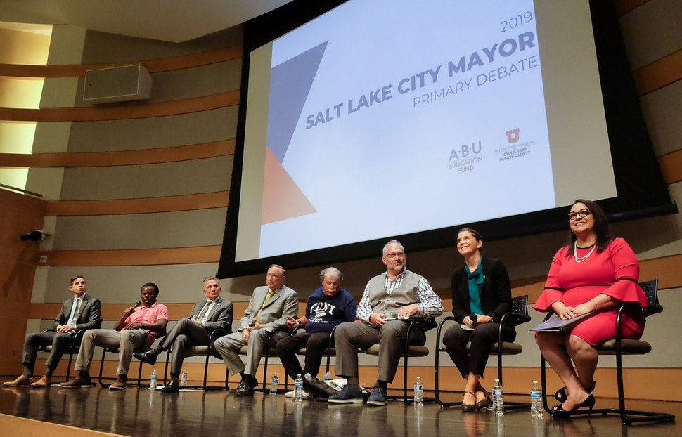 (Francisco Kjolseth | The Salt Lake Tribune) All eight of the candidates for Salt Lake City mayor gather for a debate at the Salt Lake City Library on Wed. June 26, 2019, which includes, from left, David Garbett, Abi Olufeko standing in for Rainer Huck, David Ibarra, Jim Dabakis, Richard Goldberger, Stan Penfold, Erin Mendenhall and Luz Escamilla. The debate was hosted by the ABU Education Fund and the University of Utah's John R. Park Debate Society and moderated by Averie Vockel.
