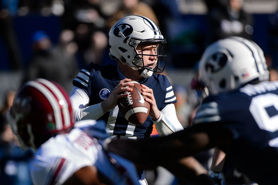 (Trent Nelson | The Salt Lake Tribune) Brigham Young Cougars quarterback Joe Critchlow (11) as BYU hosts the University of Massachusetts, NCAA football in Provo, Saturday November 18, 2017.