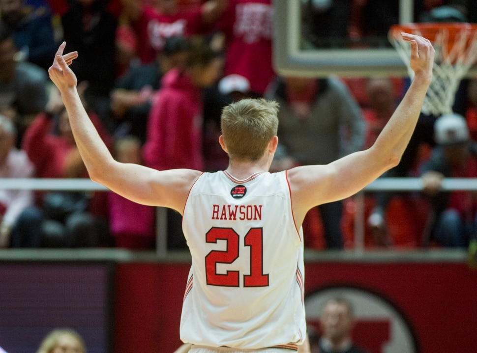 (Rick Egan | The Salt Lake Tribune) Utah Utes forward Tyler Rawson (21) celebrates as the Utes take a 27-9 lead in the first quarter, in NIT playoff action between Utah Utes and LSU Tigers at the Jon M. Huntsman Center, Monday, March 19, 2018.