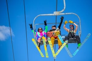 (Trent Nelson  |  The Salt Lake Tribune) Skiers dance to music from their boom box on the lift at Solitude on Saturday, April 17. The resort announced Monday that it would extend its season and keep its lifts running Thursday through Sunday this week.