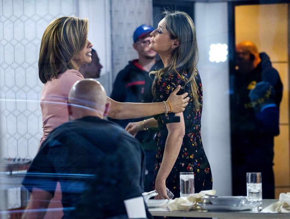 (Associated Press file photo | Craig Ruttle) Co-anchor Hoda Kotb, left, reaches out to Savannah Guthrie on the set of the