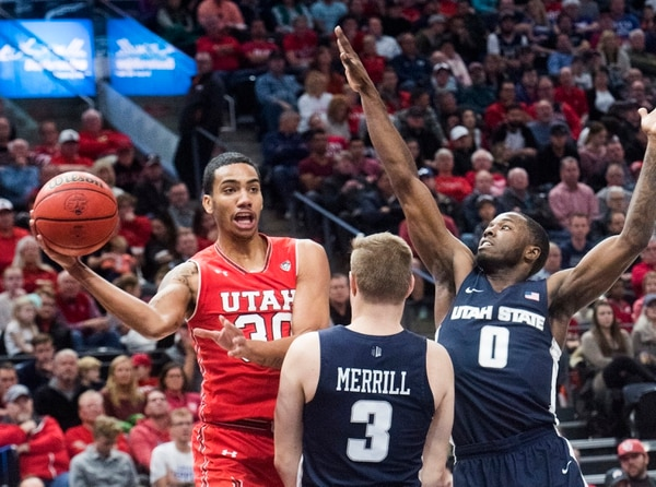 (Rick Egan | The Salt Lake Tribune) Utah Utes guard Gabe Bealer (30) tosses a pass around Utah State Aggies guard Sam Merrill (3) and Utah State Aggies guard DeAngelo Isby (0), in Beehive Classic basketball action at the Vivint SmartHome Arena, Saturday, December 9, 2017.