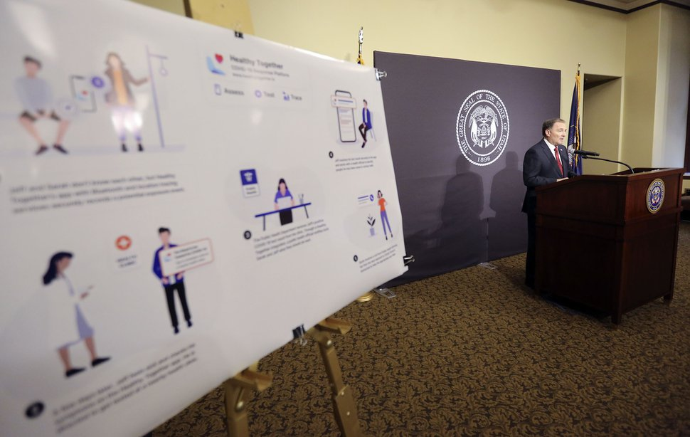 (Kristin Murphy, Deseret News/pool) In this April 22, 2020, file photo, Gov. Gary Herbert speaks during the daily COVID-19 media briefing at the Capitol in Salt Lake City. A poster displaying how the Healthy Together app will use location tracking for COVID-19 contact tracing is on display in the foreground.