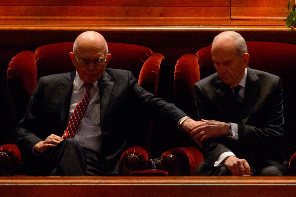 (Trent Nelson | The Salt Lake Tribune) President Russell M. Nelson, right, gets a sign of support from Dallin H. Oaks before the start of the General Conference of The Church of Jesus Christ of Latter-day Saints in Salt Lake City, Saturday Oct. 6, 2018. At right is Henry B. Eyring.