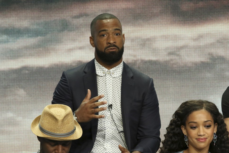 Professional football player Spencer Paysinger participates in the The CW Network