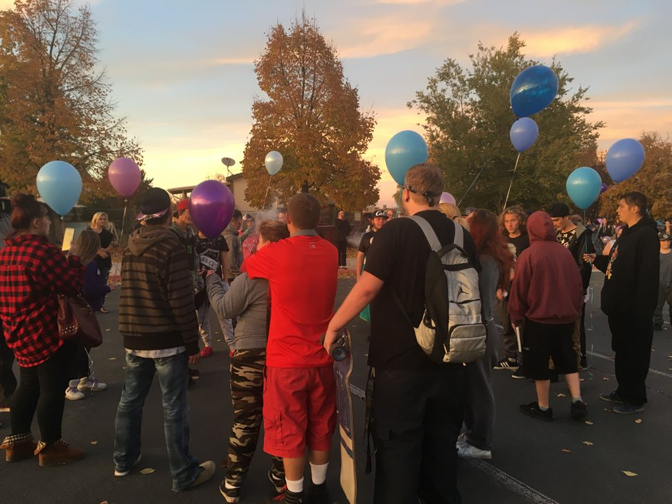 (Mariah Noble | The Salt Lake Tribune) Friends of Joshua Belen gathered to remember him Monday night, after he was shot and killed Saturday, Oct. 21, 2017. During the gathering, Belen's friends released blue and purple balloons in his memory.