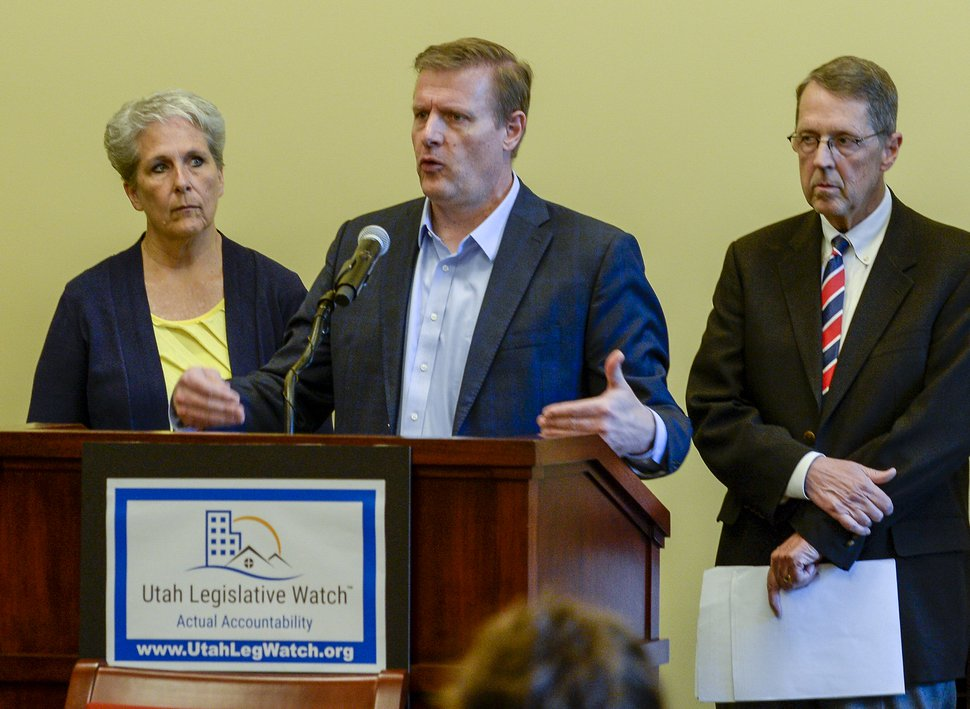 (Leah Hogsten | Tribune file photo) Brett Hastings, center with Utah Legislative Watch calls for a cut to the state budget, Tuesday at the Capitol. Utah Legislative Watch held a press conference, May 21, 2019 to formally announce the creation of Utah Legislative Watch.