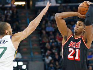 Miami Heat center Hassan Whiteside (21) shoots as Utah Jazz center Rudy Gobert (27) defends in the first half during an NBA basketball game Friday, Nov. 10, 2017, in Salt Lake City. (AP Photo/Rick Bowmer)
