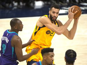 (Rick Egan | The Salt Lake Tribune) Utah Jazz center Rudy Gobert (27) holds the ball as Charlotte Hornets center Bismack Biyombo (8) defends, in NBA action between the Utah Jazz and the Charlotte Hornets at Vivint Arena, on Monday, Feb. 22, 2021.