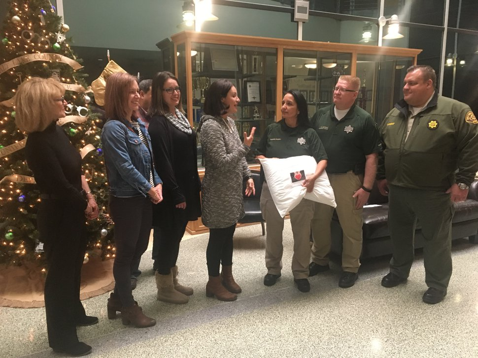 (Tiffany Caldwell | The Salt Lake Tribune) The Suite family — Annette Suite, Cassandra Suite-Smith, Celeste Suite and Sabrena Suite-Mangum — donated more than 600 pillows to the Salt Lake County jail on Friday, Dec. 22, 2017. Salt Lake County Sheriff Rosie Rivera, Lt. Brent Dietrich and Chief Deputy Matt Dumont accepted a ceremonial pillow.