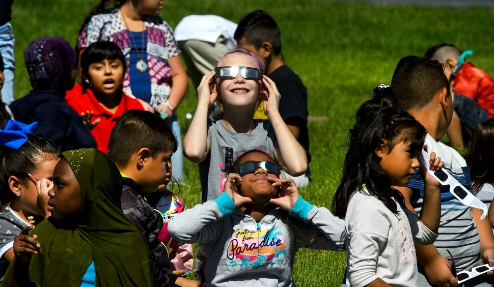 (Steve Griffin | The Salt Lake Tribune) Meadowlark Elementary School students watch The Great Eclipse during the Salt Lake School District's first day of the 2017-2018 school year. STEAM teacher-coordinator Wendi Laurence who formerly worked at NASA has been planning an event around the eclipse. All students had glasses to view the event and many had lunch outside at the Salt Lake City school Monday August 21, 2017.