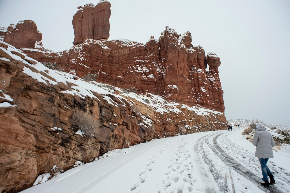 (Rick Egan | The Salt Lake Tribune) Hikers are allowed to hike along the closed roads, inside Arches National Park, as it remains closed due to the partial government shutdown. Sunday, Jan. 6, 2019.