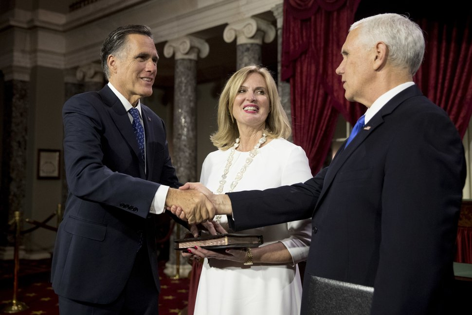 (Andrew Harnik | AP) Vice President Mike Pence shakes hands with Sen. Mitt Romney, R-Utah, accompanied by his wife Ann, following a mock swearing in ceremony in the Old Senate Chamber on Capitol Hill in Washington, Thursday, Jan. 3, 2019, as the 116th Congress begins.