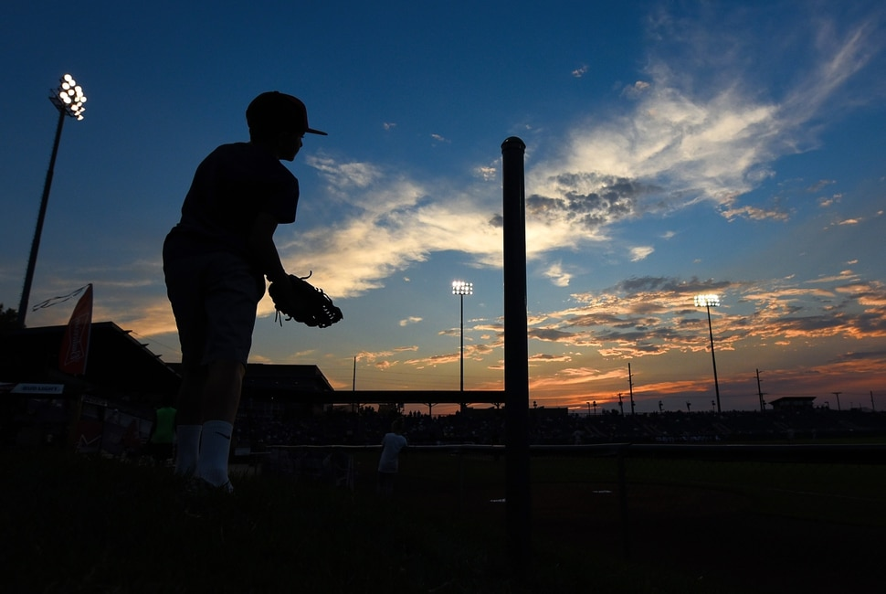(Francisco Kjolseth | The Salt Lake Tribune) Jonathan Hall, 9, keeps an eye on the game and his glove ready in hopes of a ball as the sun sets on the Raptors game at Lindquist Field in Ogden. The general admission section along the first-base line offers an unique and intimate experience as young fans can be close to the action.