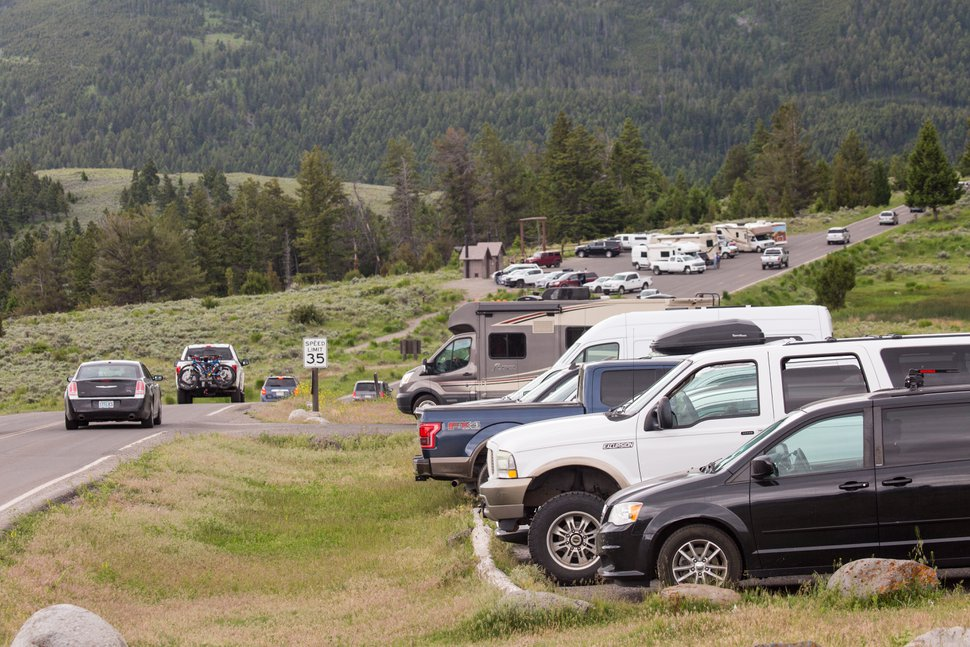 (Jacob W. Frank | NPS) Cars crowd parking lots at Mammoth Hot Springs in Yellowstone National Park.