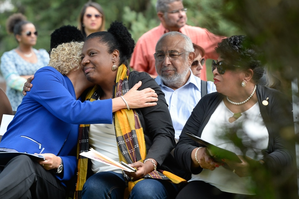 (Francisco Kjolseth | The Salt Lake Tribune) Mayor Jackie Biskupski, left, embraces Rep. Sandra Hollins, D-Salt Lake, alongside Jeanetta Williams, NAACP President as they attend a grave marker dedication at the Salt Lake City Cemetery for Tom, an enslaved Black pioneer who was buried in the Salt Lake City Cemetery in 1862. The placement and dedication of the marker on Thursday, Aug. 22, 2019, is the result of research initially conducted by Mark Smith, the former sexton of the Cemetery.