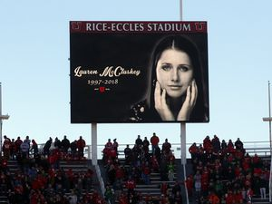 (Rick Bowmer | AP file photo)  An image of University of Utah student and track athlete Lauren McCluskey, who was fatally shot on campus, is projected on the video board before the start of an NCAA college football game between Oregon and Utah on Nov. 10, 2018, in Salt Lake City. McCluskey's parents reached a $13.5 million settlement Thursday, Oct. 22, 2020, with the University of Utah, which acknowledged that it didn't handle McCluskey's case properly.