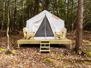 (Photo courtesy of Tentrr) The Utah Division of Parks and Recreation has teamed up with Tentrr to create 48 campsites across five state parks this season. Designed as a bridge between a campsite and a hotel, sites are set away from other campgrounds. They feature an already set-up tent, a queen bed set on a raised platform, chairs and a rudimentary shower and toilet, among other amenities.