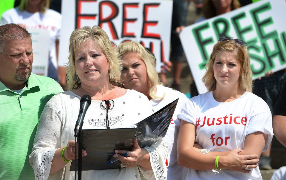 (Scott Sommerdorf | Tribune file photo) Laurie Holt, Josh Holt's mother, speaks at a rally on the east steps of the Utah State Capitol on July 30, 2016, calling for the release of her then-24-year-old son Josh Holt, who was jailed in Venezuela. At left is her husband, Jason Holt, with Josh's sisters Katie and Jenna Holt, far right. Laurie Holt died Feb. 10, 2019, at age 50.