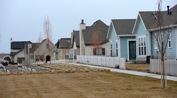 Al Hartmann | The Salt Lake Tribune Houses at Daybreak are clustered around open spaces of grass and gardens.