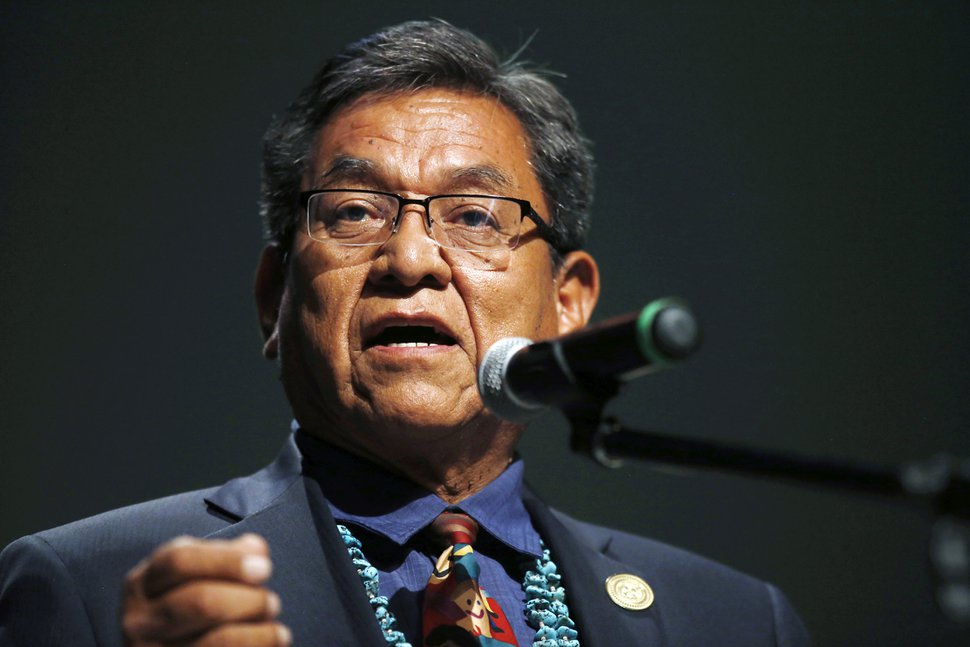 FILE - In this July 20, 2015 file photo, Navajo Nation President Russell Begaye talks with community members during a public meeting in Shiprock, N.M. The top two leaders on the Navajo Nation say recent suicides in communities affected by a mine spill have shaken reservation towns to their core. (Jon Austria/The Daily Times via AP, File) MANDATORY CREDIT