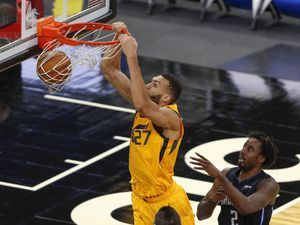 Utah Jazz center Rudy Gobert (27) scores in front of Orlando Magic forward Al-Farouq Aminu (2) in the first quarter during an NBA basketball game, Saturday Feb. 27, 2021, in Orlando, Fla. (AP Photo/Joe Skipper)