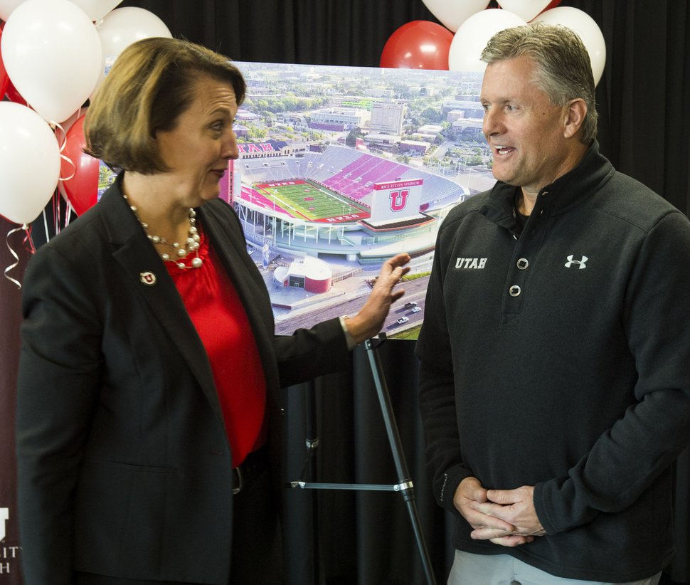 (Rick Egan | The Salt Lake Tribune) University of Utah president, Ruth Watkins, jokes with head coach Kyle Whittingham, after a news conference about the new stadium expansion, at Rice-Eccles stadium, Wednesday, Nov. 14, 2018.
