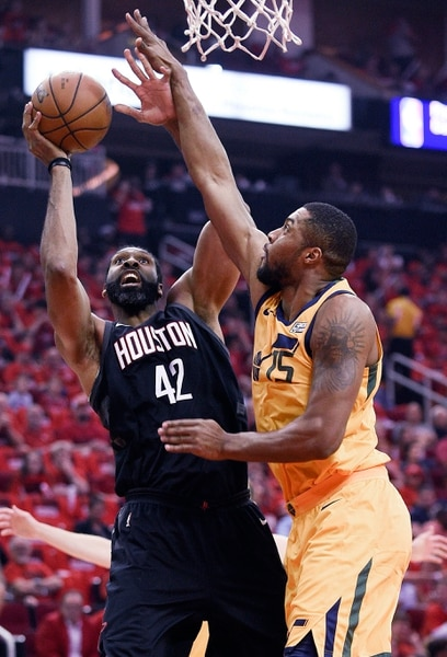 Houston Rockets center Nene Hilario (42) shoots as Utah Jazz forward Derrick Favors defends during the first half in Game 1 of an NBA basketball second-round playoff series, Sunday, April 29, 2018, in Houston. (AP Photo/Eric Christian Smith)