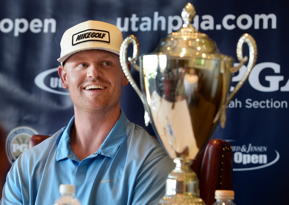 (Scott Sommerdorf | The Salt Lake Tribune) Patrick Fishburn relaxes with his trophy after winning the Utah Open golf tournament played at the Riverside Country Club, Sunday, August 27, 2017. Fishburn crushed the field, with a 26 under score, nine strokes ahead of second place finisher Zahkai Brown at -17.