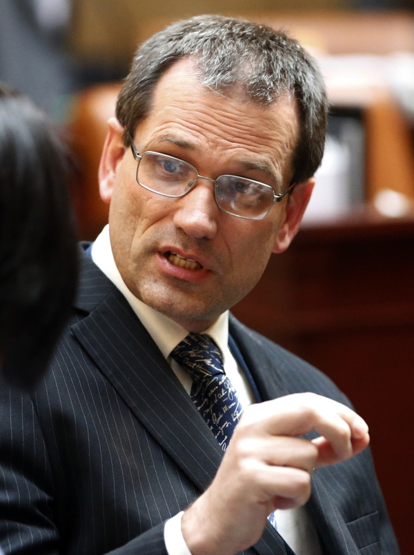 FILE - In this Jan. 23, 2018, file photo, Republican state Rep. Ray Ward talks on the House floor, in Salt Lake City. Utah's House of Representatives has passed legislation barring abortions sought because a fetus has been diagnosed with Down syndrome. Ward unsuccessfully tried to amend the bill to require that the state pay $1.8 million annually to provide services to people with Down syndrome. (AP Photo/Rick Bowmer, File)