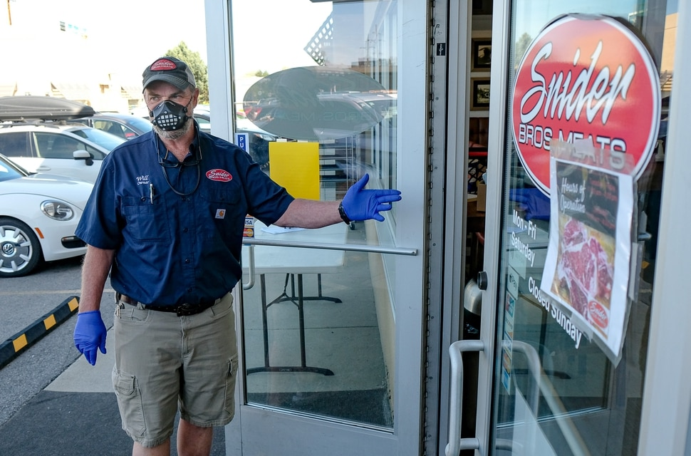 (Francisco Kjolseth | The Salt Lake Tribune) Will Wilson, co-owner of Snider Brothers Meats in Cottonwood Heights controls the flow of customers to his store on Tuesday, May 5, 2020, where he has been requiring that all customers wear masks or facial coverings when they come to shop due to the coronavirus pandemic.