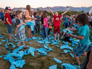 (Trent Nelson     The Salt Lake Tribune) Children rip up a large paper mask at a rally protesting government mask mandates at the State Capitol in Salt Lake City on Saturday, Sept. 5, 2020.